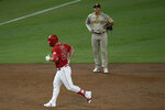 Los Angeles Angels' Mike Trout, front, rounds the bases past San Diego Padres third baseman Manny Machado after hitting a two-run home run during the third inning of a baseball game, Wednesday, Sept. 2, 2020, in Anaheim, Calif. (AP Photo/Jae C. Hong)