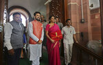 Indian Finance Minister Nirmala Sitharaman, second right, and junior Finance Minister Anurag Thakur, second left, stands for the media outside the parliament house before unveiling the annual federal budget in New Delhi, India, Friday, July 5, 2019. India's government says the economy is expected to grow at 7% in 2019-20, up from a five-year low of 6.8% in the past year. (AP Photo/Manish Swarup)