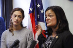 Negah Hekmati, left, looks on as Rep. Pramila Jayapal, D-Wash., addresses a news conference about Hekmati's ordeal during an hours-long delay returning to the U.S. from Canada with her family days earlier, Monday, Jan. 6, 2020, in Seattle. Civil rights groups and lawmakers were demanding information from federal officials following reports that dozens of Iranian-Americans were held up and questioned at the border as they returned to the United States from Canada over the weekend. In a statement Sunday, the Washington state chapter of the Council on American-Islamic Relations said more than 60 Iranians and Iranian-Americans were detained and questioned at the Peace Arch Border Crossing in Blaine, Washington. (AP Photo/Elaine Thompson)