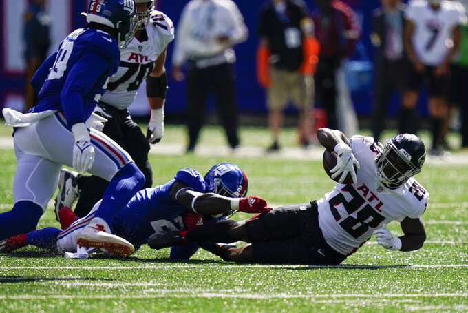 Atlanta Falcons running back Mike Davis (28) is tackled by New York Giants free safety Jabrill Peppers (21) before fumbling for a recover by Giant's Lorenzo Carter during the first half of an NFL football game, Sunday, Sept. 26, 2021, in East Rutherford, N.J. (AP Photo/Seth Wenig)