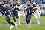 Tennessee Titans wide receiver A.J. Brown (11) runs 49 yards for a touchdown against the New Orleans Saints in the first half of an NFL football game Sunday, Dec. 22, 2019, in Nashville, Tenn. (AP Photo/James Kenney)