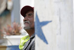 In this Monday, Jan. 21, 2019, photo, Mario Silva sits outside of his home in El Paso, Texas. Silva's home backs up to a border barrier that runs along the Texas-Mexico border in El Paso.n(AP Photo/Eric Gay)