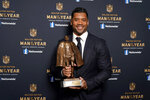 Seattle Seahawks quarterback Russell Wilson poses with his trophy after winning the Walter Payton NFL Man of the Year award during the NFL Honors ceremony as part of Super Bowl 55 Friday, Feb. 5, 2021, in Tampa, Fla. (AP Photo/Charlie Riedel)