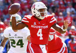 Houston quarterback D'Eriq King (4)  looks to pass during the first half of an NCAA college football game against South Florida, Saturday, Oct. 27, 2018, in Houston. (AP Photo/Eric Christian Smith)