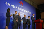 Glen Nager, Partner at Jones Day, right, speaks during a press conference of Huawei in Shenzhen city, China's Guangdong province, Thursday, March 7, 2019. Chinese tech giant Huawei is launching a U.S. court challenge to a law that labels the company a security risk and would limit its access to the American market for telecom equipment. (AP Photo/Kin Cheung)