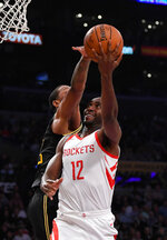 Houston Rockets forward Luc Mbah a Moute, right, shoots as Los Angeles Lakers forward Channing Frye defends during the first half of an NBA basketball game Tuesday, April 10, 2018, in Los Angeles. (AP Photo/Mark J. Terrill)