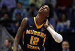Murray State's Ja Morant (12) looks up at the scoreboard during the first half of a second round men's college basketball game against Florida State in the NCAA Tournament, Saturday, March 23, 2019, in Hartford, Conn. (AP Photo/Elise Amendola)