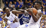 Duke's RJ Barrett, left, and Zion Williamson struggle with Georgia Tech's Abdoulaye Gueye (34) for a rebound during the first half of an NCAA college basketball game in Durham, N.C., Saturday, Jan. 26, 2019. (AP Photo/Gerry Broome)