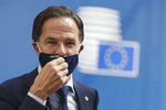 FILE- In this Monday July 20, 2020, file photo Dutch Prime Minister Mark Rutte arrives for an EU summit in Brussels. The Dutch Cabinet was set to meet Friday Jan. 15, 2021, amid strong speculation that Prime Minister Mark Rutte's government will resign to take political responsibility for a scandal involving child benefit investigations. (Stephanie Lecocq, Pool Photo via AP)