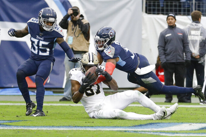 New Orleans Saints tight end Jared Cook (87) catches a 16-yard touchdown pass as he is defended by Tennessee Titans free safety Kevin Byard, right, and cornerback Tramaine Brock Sr. (35) in the second half of an NFL football game Sunday, Dec. 22, 2019, in Nashville, Tenn. (AP Photo/James Kenney)