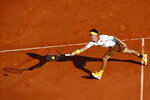 Japan's Key Nishikori returns the ball to Germany's Alexander Zverev during their semifinal singles match of the Monte Carlo Tennis Masters tournament in Monaco, Saturday April 21, 2018. (AP Photo/Christophe Ena)