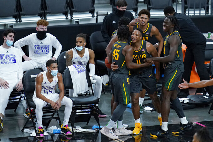 Baylor's Mark Vital (11) celebrates with teammates after a play against Washington during the second half of an NCAA college basketball game Sunday, Nov. 29, 2020, in Las Vegas. (AP Photo/John Locher)
