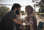This image released by Netflix shows Fayssal Bazzi, left, and Soraya Heidari in a scene from