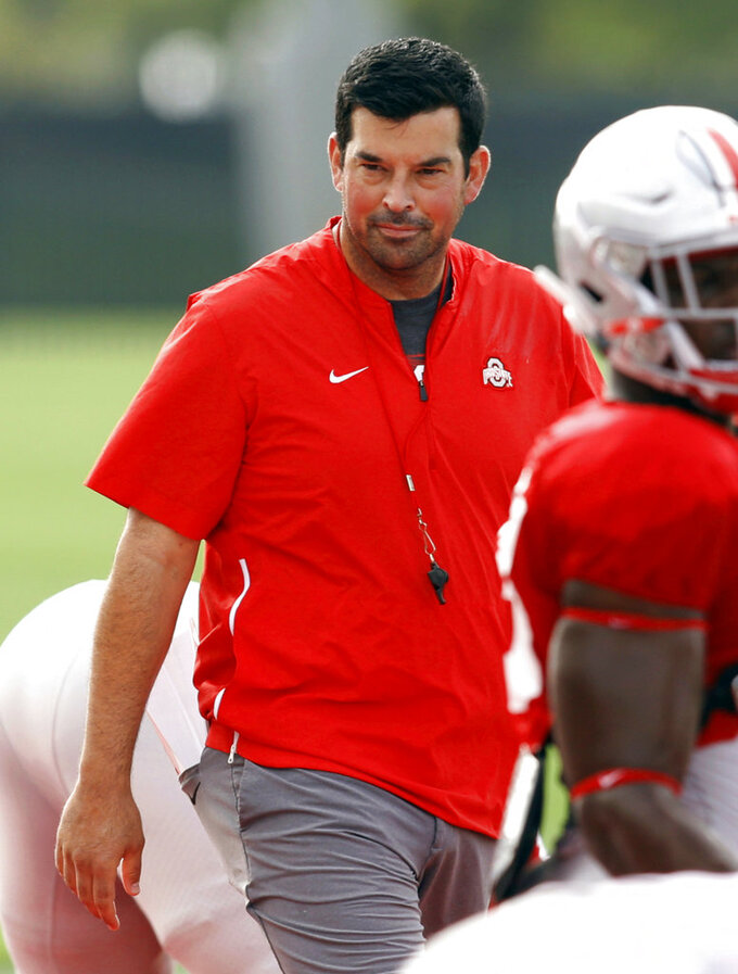 FILE - In this Aug. 18, 2018, file photo, acting Ohio State University football coach Ryan Day is seen during NCAA college football practice in Columbus, Ohio. Ohio State head coach Urban Meyer, the highly successful coach who won three national championships and sparked controversy and criticism this season for his handling of domestic violence allegations against a now-fired assistant, will retire after the Rose Bowl, the university announced Tuesday, Dec. 4, 2018. (AP Photo/Paul Vernon, File)