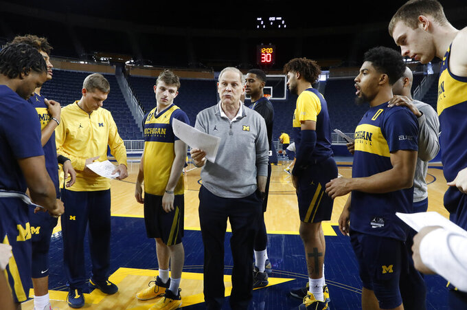 Michigan head basketball coach John Beilein talks during practice in Ann Arbor, Mich., Tuesday, Feb. 19, 2019. Beilein and Michigan State's Tom Izzo are friendly rivals, whose highly ranked NCAA college basketball teams will play for the first time this season on Sunday at Crisler Arena. As much as Beilein and Izzo genuinely like and respect each other, the highly competitive coaches want to win. (AP Photo/Paul Sancya)