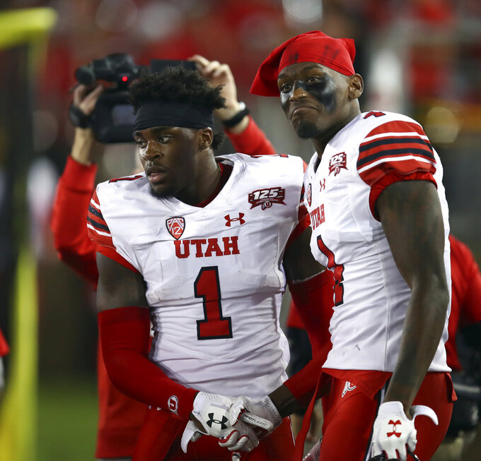 Utah's Tyrone Young-Smith, right, congratulates Jaylon Johnson (1) after Johnson scored a touchdown against Stanford during the first half of an NCAA college football game Saturday, Oct. 6, 2018, in Stanford, Calif. (AP Photo/Ben Margot)