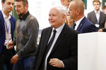 The ruling party leader Jaroslaw Kaczynski leaves polling station after his vote in Warsaw, Poland, Sunday, Oct. 13, 2019. Poles are voting Sunday in a parliamentary election that Kaczynski is favored to win easily, buoyed by the popularity of its social conservatism and generous social spending policies that have reduced poverty. (AP Photo/Darko Bandic)