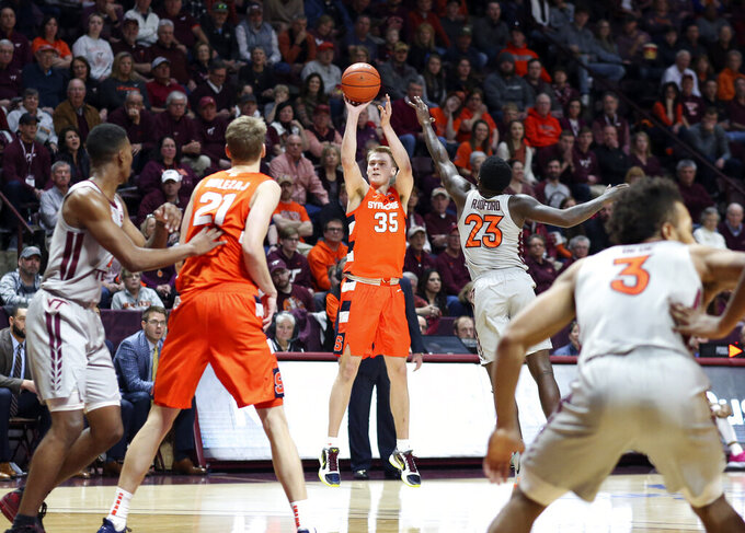 Syracuse's Buddy Boeheim (35) shoots 3 -point shot over the Virginia Tech defense during the first half of an NCAA college basketball game in Blacksburg Va., Saturday, Jan. 18 2020. (Matt Gentry/The Roanoke Times via AP)