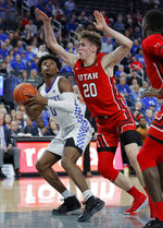 Kentucky's Ashton Hagans (0) looks for a shot as Utah's Mikael Jantunen (20) defends during the second half of an NCAA college basketball game Wednesday, Dec. 18, 2019, in Las Vegas. (AP Photo/John Locher)