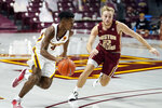 Minnesota's Jamal Washburn Jr. (4) drives on Boston College's Rich Kelly during the first half of an NCAA college basketball game Tuesday, Dec. 8, 2020, in Minneapolis. (AP Photo/Jim Mone)