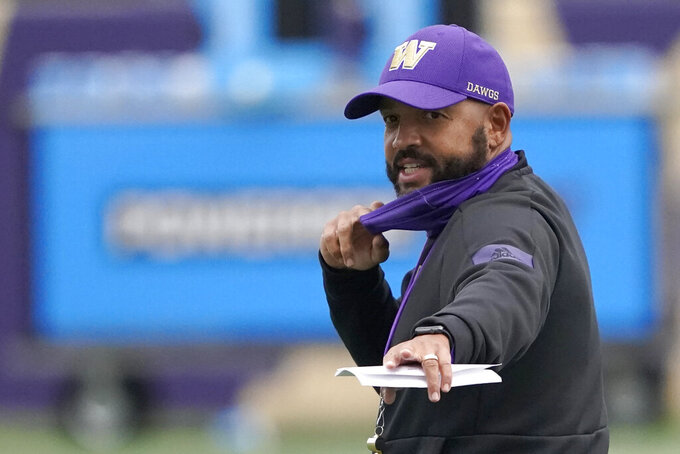 Washington head coach Jimmy Lake gives instructions during NCAA college football practice, Friday, Oct. 16, 2020, in Seattle. (AP Photo/Ted S. Warren)