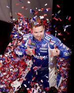 Ricky Stenhouse Jr. tosses confetti for a promotion in a 360 degree photo booth during media day for the NASCAR Daytona 500 auto race at Daytona International Speedway, Wednesday, Feb. 14, 2018, in Daytona Beach, Fla. (AP Photo/John Raoux)