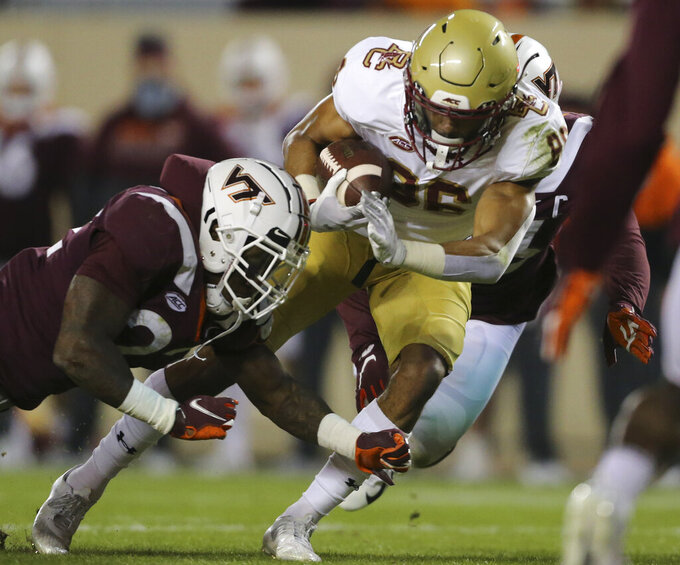 Jaelen Gill, right, of Boston College scores past Virginia Tech defenders Chamarri Conner, left, first half of an NCAA college football game in Blacksburg Va. Saturday, Oct. 17, 2020. (Matt Gentry/The Roanoke Times via AP, Pool)