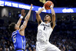 Xavier guard Paul Scruggs (1) rises for a shot as Creighton guard Ty-Shon Alexander (5) defends in the first half of an NCAA college basketball game Saturday, Jan. 11, 2020, in Cincinnati. (Kareem Elgazzar/The Cincinnati Enquirer via AP)