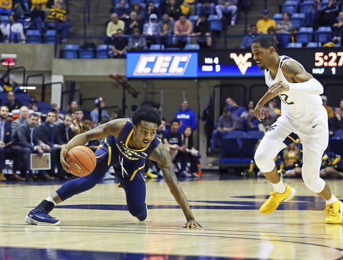 Northern Colorado's Tre'Shon Smoots is defended by West Virginia's Tax Sherman as he gets tripped up on the court during the first half of an NCAA college basketball game Monday Nov. 18, 2019, Morgantown, W.Va. (AP Photo/Kathleen Batten)
