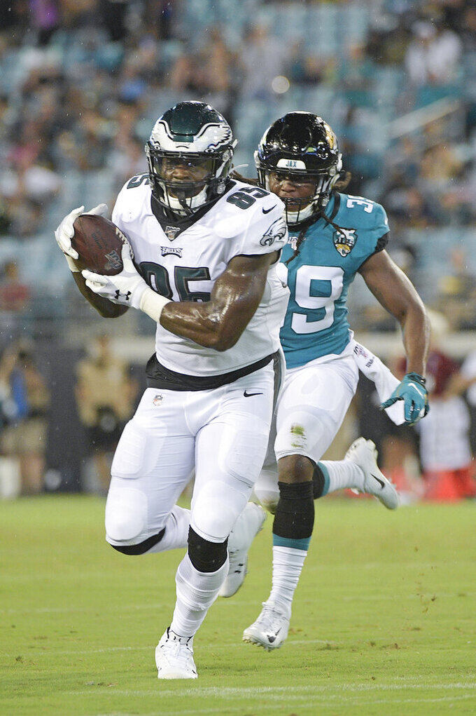 Philadelphia Eagles tight end Will Tye makes a reception in front of Jacksonville Jaguars safety Joshua Moon during the second half of an NFL preseason football game Thursday, Aug. 15, 2019, in Jacksonville, Fla. (AP Photo/Phelan M. Ebenhack)
