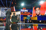 An image of Ohio State quarterback Justin Fields is displayed after he was chosen by the Chicago Bears with the 11th pick in the first round of thge NFL football draft Thursday, April 29, 2021, in Cleveland. (AP Photo/Tony Dejak)