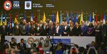 Colombia's President Ivan Duque, center, waves to the crowd during the General Assembly of the Organization of American States (OAS) opening ceremony in Medellin, Colombia, Wednesday, June 26, 2019. The meeting runs through June 28. (AP Photo/Luis Benavides)