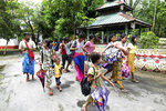 Ethnic Rakhine villagers arrive at a temporary monastery camp with their belongings, Monday, June 29, 2020, in Sittwe, Rakhine State, Myanmar. Thousands of people in an area of western Myanmar where there have been clashes between the government and ethnic rebels have been fleeing from their villages after an evacuation order from officials, despite being revoked several days ago. (AP Photo)