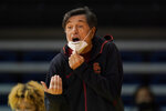 Southern California head coach Mark Trakh gestures toward players during the first half of his team's NCAA college basketball game against Stanford in Santa Cruz, Calif., Sunday, Jan. 24, 2021. (AP Photo/Jeff Chiu)