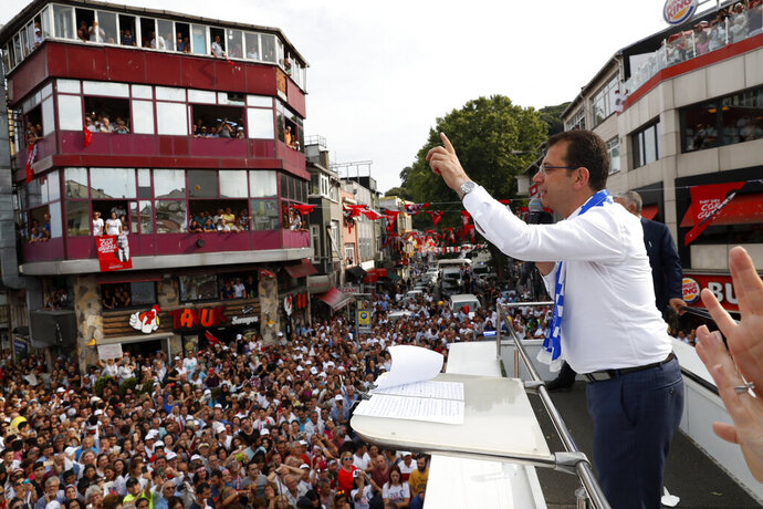 FILE  - In this Friday, June 21, 2019 file photo, Ekrem Imamoglu, candidate of the secular opposition Republican People's Party, or CHP, waves to supporters during a rally in Istanbul, ahead of the June 23 re-run of Istanbul elections.Voters in Istanbul return to the polls on Sunday for a rerun of the election for the mayor of the city. (AP Photo/Lefteris Pitarakis, File)