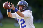 FILE - Duke quarterback Gunnar Holmberg takes a snap during an NCAA college football practice in Durham, N.C., in this Thursday, Aug. 5, 2021, file photo. The Blue Devils are coming off a two-win season.  (AP Photo/Gerry Broome, File)