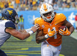 Tennessee's Dominick Wood-Anderson (4) catches a touchdown pass in front of West Virginia's Dylan Tonkery (10) in the first half of an NCAA college football game in Charlotte, N.C., Saturday, Sept. 1, 2018. (AP Photo/Chuck Burton)