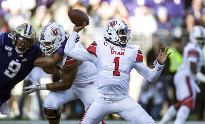 Utah quarterback Tyler Huntley passes during the second half of an NCAA college football game against Washington, Saturday, Nov. 2, 2019 in Seattle. Utah won 33-28. (AP Photo/Stephen Brashear)