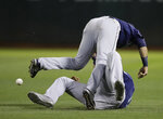 Seattle Mariners' Austin Nola, top, collides with Domingo Santana after trying to make a catch on a ball hit by Oakland Athletics' Marcus Semien during the seventh inning of a baseball game Tuesday, July 16, 2019, in Oakland, Calif. Semien doubled. (AP Photo/Ben Margot)