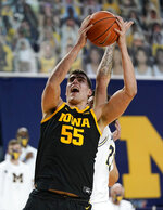 FILE - Iowa center Luka Garza makes a layup during the first half of an NCAA college basketball game against Michigan in Ann Arbor, Mich., in this Thursday, Feb. 25, 2021, file photo. Iowa's Luka Garza is The Associated Press player of the year in the Big Ten for the second year in a row and a member of The AP All-Big Ten first team announced Tuesday, March 9, 2021. (AP Photo/Carlos Osorio, File)