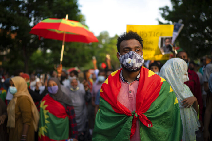 FILE - In this Wednesday, July 1, 2020 file photo, protesters outraged by the killing of popular Ethiopian singer Hachalu Hundessa walk along Lexington Avenue after exiting off westbound Interstate 94, in St. Paul, Minn. Ethiopian officials said Wednesday, July 8, 2020 that at least 239 people have been killed and 3,500 arrested in more than a week of unrest in Ethiopia that poses the biggest challenge yet to its Nobel Peace Prize-winning prime minister. (Jeff Wheeler/Star Tribune via AP, File)