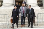 Former University of Southern California assistant basketball coach  Tony Bland, center, leaves Manhattan federal court in New York, Wednesday, Jan. 2, 2019. Bland pleaded guilty Wednesday in a criminal case in which prosecutors said bribes were paid to steer top athletes to certain schools. (AP Photo/Mary Altaffer)