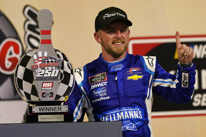 Justin Allgaier celebrates in Victory Lane after winning a NASCAR Xfinity Series auto race Friday, Sept. 11, 2020, in Richmond, Va. (AP Photo/Steve Helber)