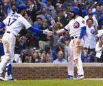 Chicago Cubs' David Bote, right, high fives Kris Bryant (17) after he scores against the St. Louis Cardinals during the fifth inning of a baseball game Sunday, June 9, 2019, in Chicago. (AP Photo/Matt Marton)