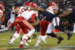 Chicago Bears outside linebacker Khalil Mack (52) sacks Kansas City Chiefs quarterback Patrick Mahomes (15) in the first half of an NFL football game in Chicago, Sunday, Dec. 22, 2019. (AP Photo/Charles Rex Arbogast)