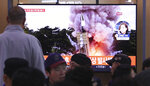 People watch a TV showing a file image of an unspecified North Korea's missile launch during a news program at the Seoul Railway Station in Seoul, South Korea, Thursday, Oct. 31, 2019. South Korea's military said North Korea on Thursday fired two projectiles toward its eastern sea, an apparent resumption of weapons tests aimed at ramping up pressure on Washington over a stalemate in nuclear negotiations. (AP Photo/Ahn Young-joon)