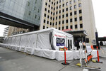 A new tent stands outside the emergency entrance of Harborview Medical Center Saturday, March 28, 2020, in Seattle. Harborview and University of Washington Medicine are preparing a