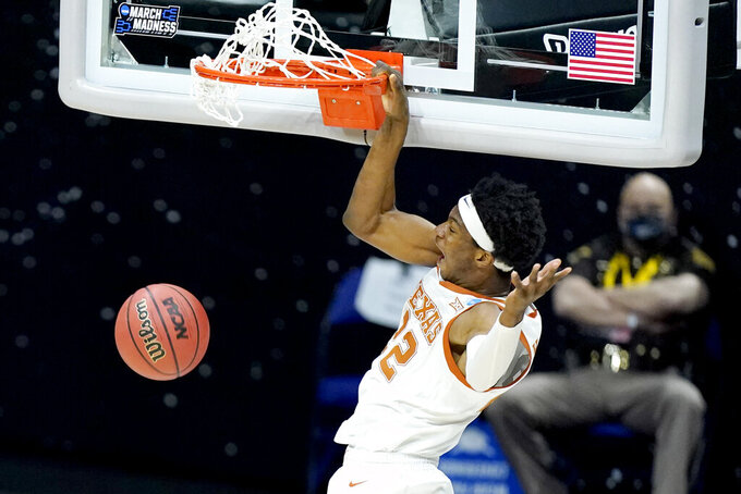 Texas' Kai Jones dunks the ball against Abilene Christian during the first half of a college basketball game in the first round of the NCAA tournament at Lucas Oil Stadium in Indianapolis Saturday, March 20, 2021. (AP Photo/Mark Humphrey)
