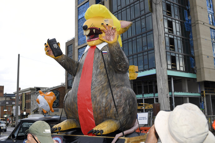 An giant inflatable rat depicting President Donald Trump is seen on the street near the U.S. House Republican Member Retreat, Thursday, Sept. 12, 2019, in Baltimore. (AP Photo/Nick Wass)