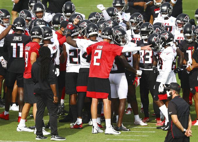 The Atlanta Falcons, led by quarterback Matt Ryan (2), take the field to begin NFL football training camp practice Saturday, Aug. 15, 2020, in Flowery Branch, Ga.  (Curtis Compton/Atlanta Journal-Constitution via AP)